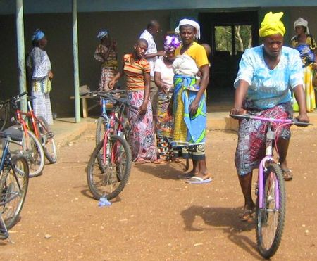 Women in Sierra Leone, Africa learning to ride their new bikes provided by Village Bicycle Project