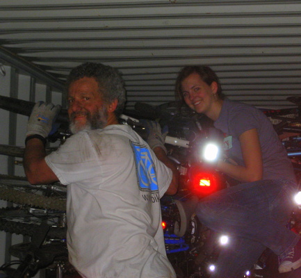 David Mozer, of Ibike.org and Ann Watson of Seattle, load bikes headed for Ghana in West Africa.