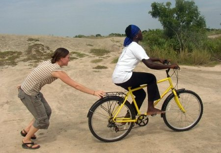 liz teaches woman to ride bike in Africa
