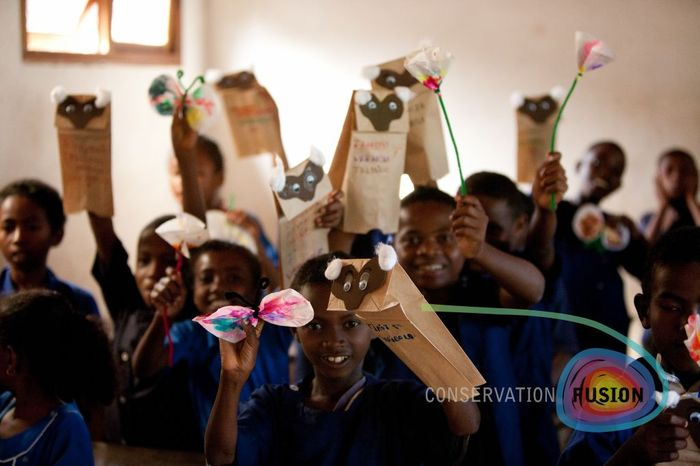 Malagasy youth create Bamboo lemur puppets and flowers.  By  learning the treasures their country possess, they are more likely to  protect it.